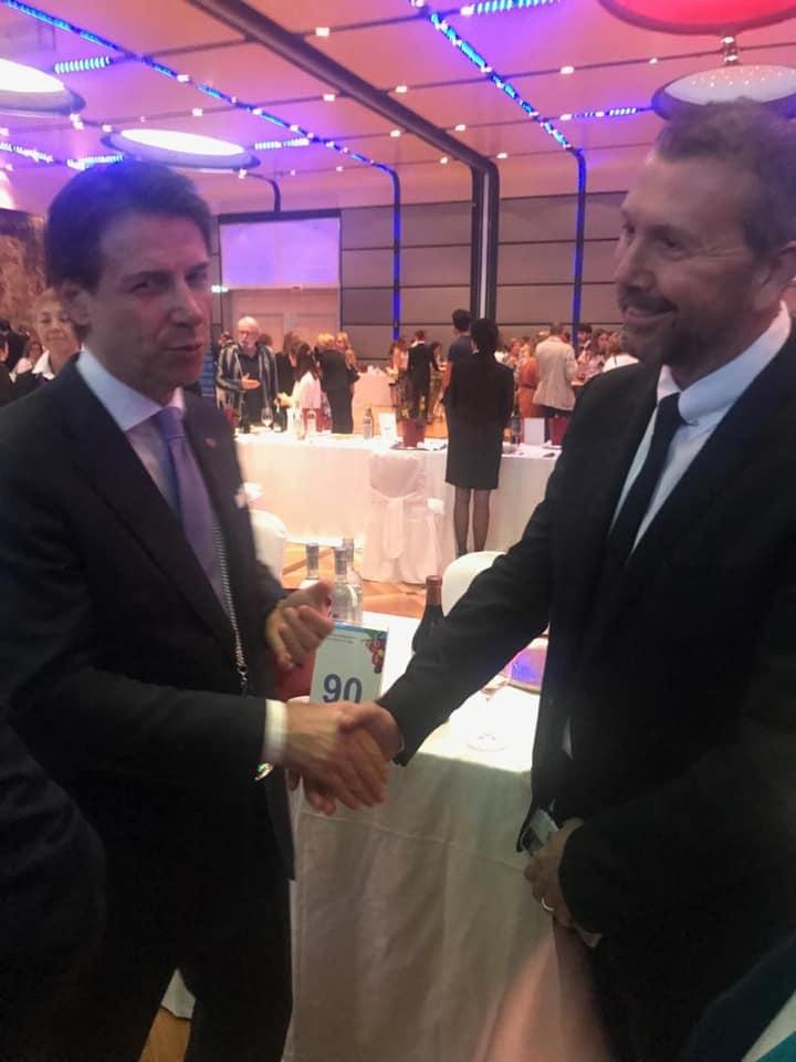 Italy's prime minister, Giuseppe Conte, compliments Valerio Civa